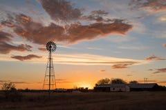 Windmill at sunset Stock Image
