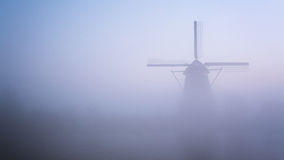 Windmill Surrounded by Fog Stock Photos