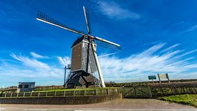 Windmill surrounded by a wood fence on a wonderful sunny day. And blue sky with white clouds in Beek, south Limburg in the Netherlands Holland royalty free stock images