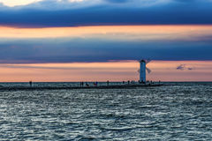 Windmill in Swinoujscie by the Baltic sea by sunset with pink an. D blue color Stock Images