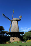 Windmill in tha garden. The scenery of windmill in the garden Royalty Free Stock Images
