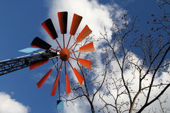 Windmill. And tree in the background of blue sky Stock Photos