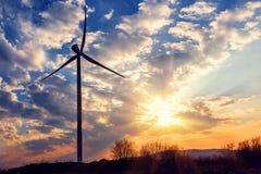 Windmill turbine on beautiful sunset Stock Images