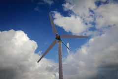 Windmill turbine at blue sky. Renewable power, wind energy Stock Images