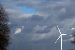 Windmill turbine creating wind green energy Stock Photos