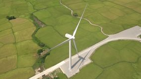 Windmill turbine on green field background. Drone view wind power turbine generation on energy station. Alternative. Energy sources, ecology and environment stock footage
