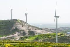 Windmill turbine  power generation farm Stock Photo