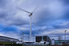Windmill turbine and power station. Modern windmill turbine and power station on a cloudy sky in England Stock Photography