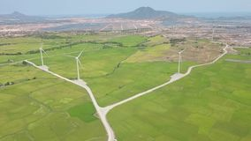 Windmill turbine on wind energy station. Alternative natural source and ecology conservation. Wind farm aerial landscape. Green technology, clean and renewable stock footage