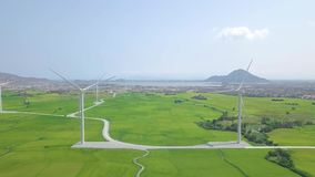 Windmill turbine on wind energy station drone view. Alternative natural source and ecology conservation. Wind farm on. Sea and mountain landscape. Green stock video