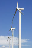A windmill turbines. In a sky blue stock photo