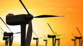 Windmill turbines clean, wind energy in the sunrise sunset sky. Green energy stock video footage