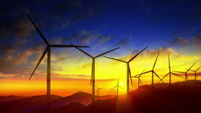 Windmill turbines harnessing clean, wind energy. 4k Beautiful windmill turbines harnessing clean, green, wind energy silhouetted in the sunrise/sunset sky with stock footage