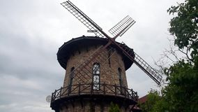 The windmill turns the blades of the wind power stock footage