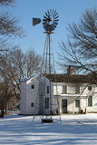 A Windmill and a Two Story Outhouse Stock Image