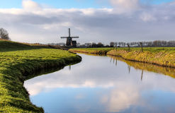 Windmill. A typical dutch landscape. in the background a windmill Royalty Free Stock Photos