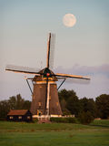 Windmill under a full moon Stock Image