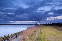 Windmill under storm Arkivfoto