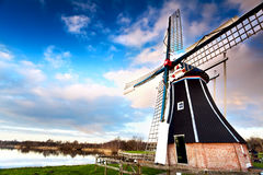 Windmill via wide angle Stock Images