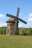 Windmill in the village. Old windmill in Ukrainian village Royalty Free Stock Photos