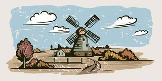 Windmill, village houses and farmland Royalty Free Stock Photos