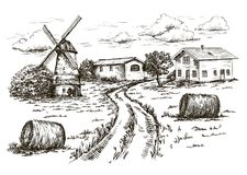 Windmill, village houses and farmland Stock Photos