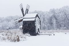 Windmill in Village Museum during snowy winter stock photos
