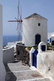 Windmill in the Village of Oia Stock Images