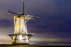 The windmill of Vlissingen by night, typical dutch scenery, historic buildings, Zeeland, the Netherlands royalty free stock image