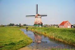 Windmill. Volendam, Netherland. A windmill along a stream, in Netherland Stock Images