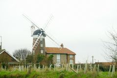 Historic Norfolk windmill at Weybourne. The Windmill was built in 1850 and consists of five storeys built from red brick. When it was in operation the sails Stock Images