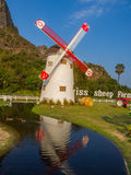 Windmill and water canal reflection in farm Stock Photo