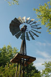 Windmill water pump. Old fashion windmill water pump Royalty Free Stock Image