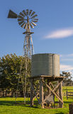 Windmill on farm. Outback windmill and water tank on farm Stock Photo