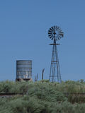 Windmill and Water Tower Royalty Free Stock Photography