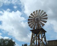 Windmill Weather. Windmill on cloudy day Royalty Free Stock Image