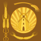 Windmill with wheat design elements Stock Image