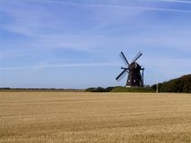 Windmill in wheat field Stock Photography