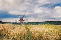 Windmill in a wheat field Stock Photography