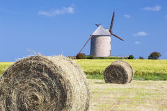 Windmill, wheat field and straw Stock Images