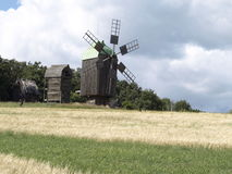Windmill in a wheat field Stock Images