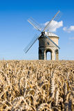 Windmill in a wheatfield in English countryside. The famous listed windmill at Chesterton in Warwickshire, England, on a sunny summer afternoon. Focus on the Stock Photo