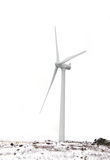 Windmill on a white background. And snow coverd ground Stock Photography