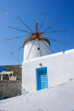Windmill. The white windmill with blue sky of Greece island Royalty Free Stock Images