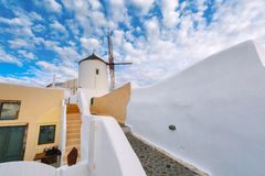 Windmill and white houses, Oia, Santorini, Greece Stock Image