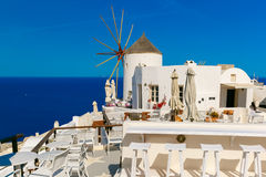 Windmill and white houses, Oia, Santorini, Greece Stock Image