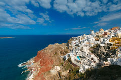 Windmill and white houses, Oia, Santorini, Greece Royalty Free Stock Images
