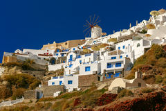 Windmill and white houses, Oia, Santorini, Greece Stock Images