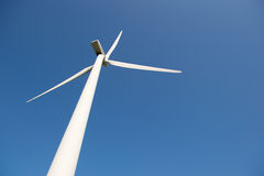Windmill for wind energy against blue sky Stock Image