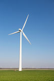 Windmill for wind energy in grass Royalty Free Stock Photos